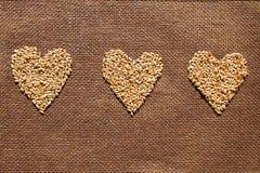 Trois coeurs des grains de blé Images stock