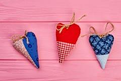 Trois coeurs faits main colorés Photos libres de droits