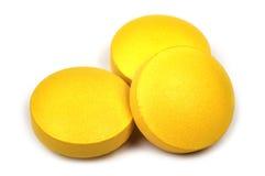 Trois comprimés jaunes Image stock
