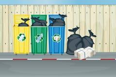 Trois couleurs différentes des poubelles Image libre de droits