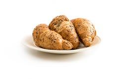 Trois croissants d'un plat blanc cassé Photo stock