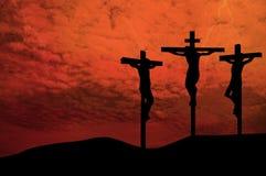 Trois croix au coucher du soleil Photographie stock