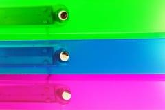 Trois dépliants multicolores Photos libres de droits