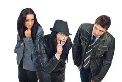 Trois détectives vérifient Photographie stock libre de droits