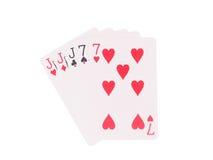 Trois d'une sorte jouant des cartes d'isolement sur le fond blanc Photo libre de droits