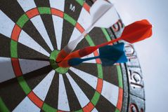 trois dards dans le concept de cible, Images stock