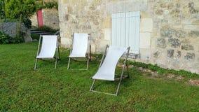 Trois Deckchairs Images stock