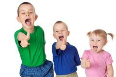 Trois enfants de mêmes parents image stock