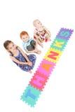 Trois enfants disant des merci avec le signe de gosses Images libres de droits