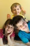 Trois enfants heureux Photographie stock libre de droits