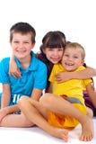 Trois enfants heureux Photo stock