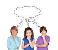 Trois enfants songeurs Photographie stock libre de droits