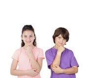 Trois enfants songeurs d'isolement Photographie stock