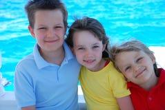 Trois enfants sur l'eau Images libres de droits
