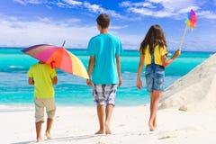 Trois enfants sur la plage Images libres de droits