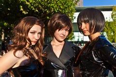 Trois filles dans le noir dans des costumes Photo libre de droits