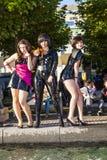 Trois filles dans le noir dans le costume Image libre de droits