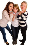 Trois filles sexy soufflant un baiser Photographie stock