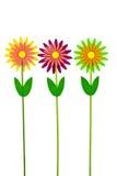 Trois fleurs artificielles colorées sur le fond blanc Images stock