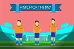 Trois footballeurs sur le stade de football Images stock