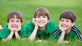Trois frères en vert Photo stock