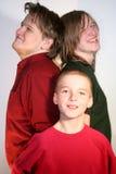 Trois frères heureux Photographie stock libre de droits