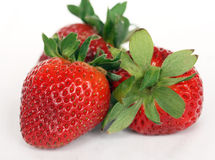 Trois fraises d'isolement Photos libres de droits