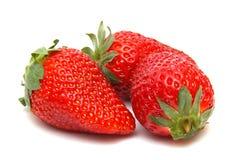 Trois fraises d'isolement Photographie stock