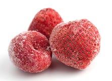 Trois fraises surgelées Image libre de droits