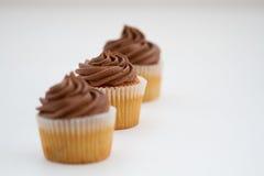Trois gâteaux de chocolat Photographie stock