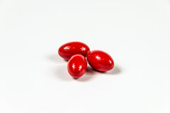 Trois gélules molles rouges photos stock
