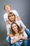 Trois générations avec une ressemblance frappante Images stock