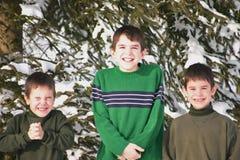 Trois garçons en hiver Photos stock