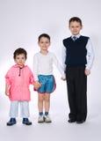 Trois garçons sur le fond blanc Photos libres de droits