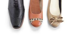 Trois genres de vue supérieure de chaussures sur l'espace blanc Photographie stock