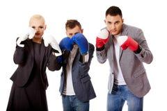 Trois gens d'affaires portant des gants de boxe Image libre de droits