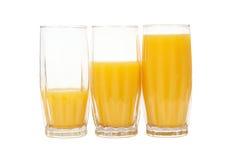 Trois glaces avec le jus d'orange Photos libres de droits