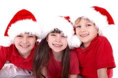 Trois gosses de Santa Photographie stock