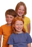 Trois gosses heureux Photo stock