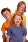Trois gosses heureux Image libre de droits