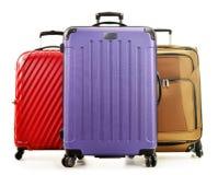 Trois grandes valises sur le fond blanc Images stock