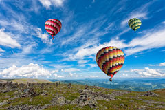 Trois grands ballons multicolores Photographie stock libre de droits