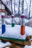 Trois grands crayons dans la neige Image libre de droits