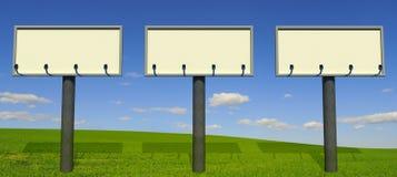 Trois grands panneaux-réclame Images stock