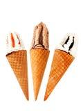 Trois hésitent des cônes de la crême glacée Photos stock