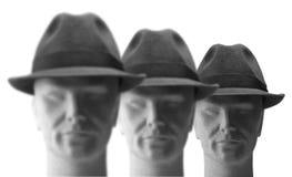 Trois hommes avec des chapeaux en fonction Image stock