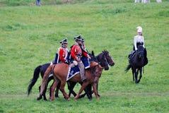 Trois hommes et chevaux d'un tour de femme Photo stock