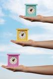 Trois horloges colorées Photographie stock libre de droits