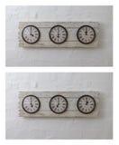 Trois horloges de voyage de mur dans différents fuseaux horaires photographie stock libre de droits