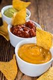 Trois immersions différentes de nacho photos libres de droits